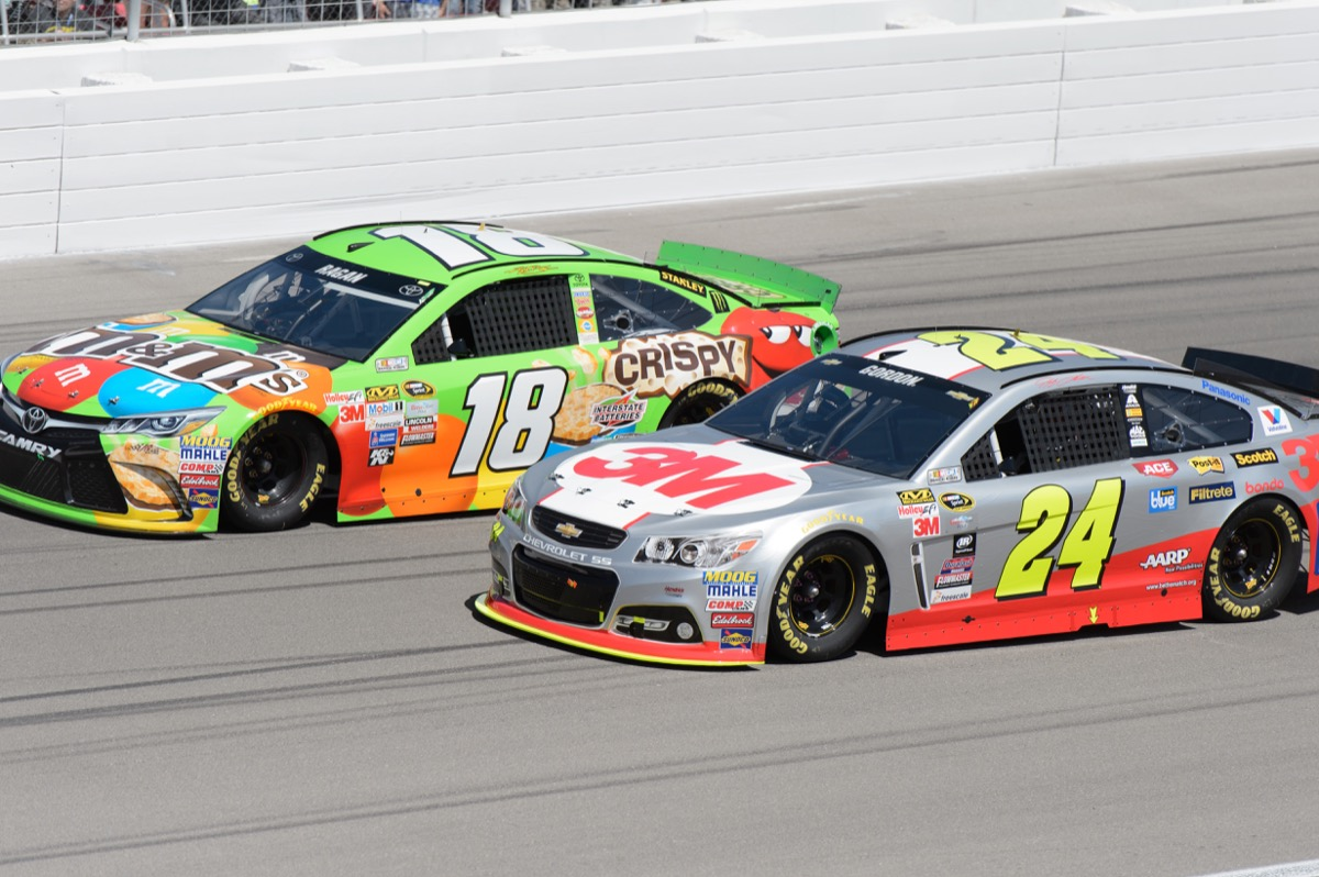 Two NASCAR cars racing on track