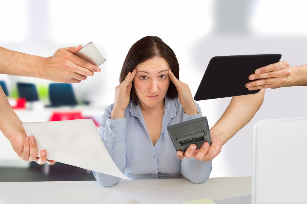 Woman is overwhelmed/stressed by so many things to do.