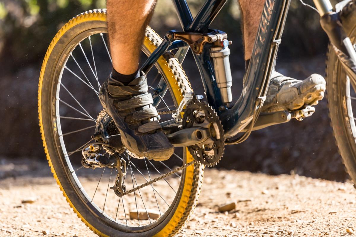 pedaling a mountain bike