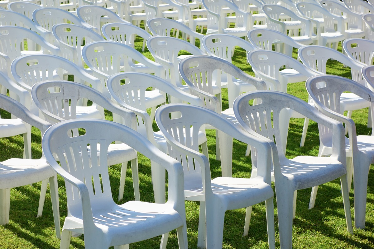 plastic chairs in the field