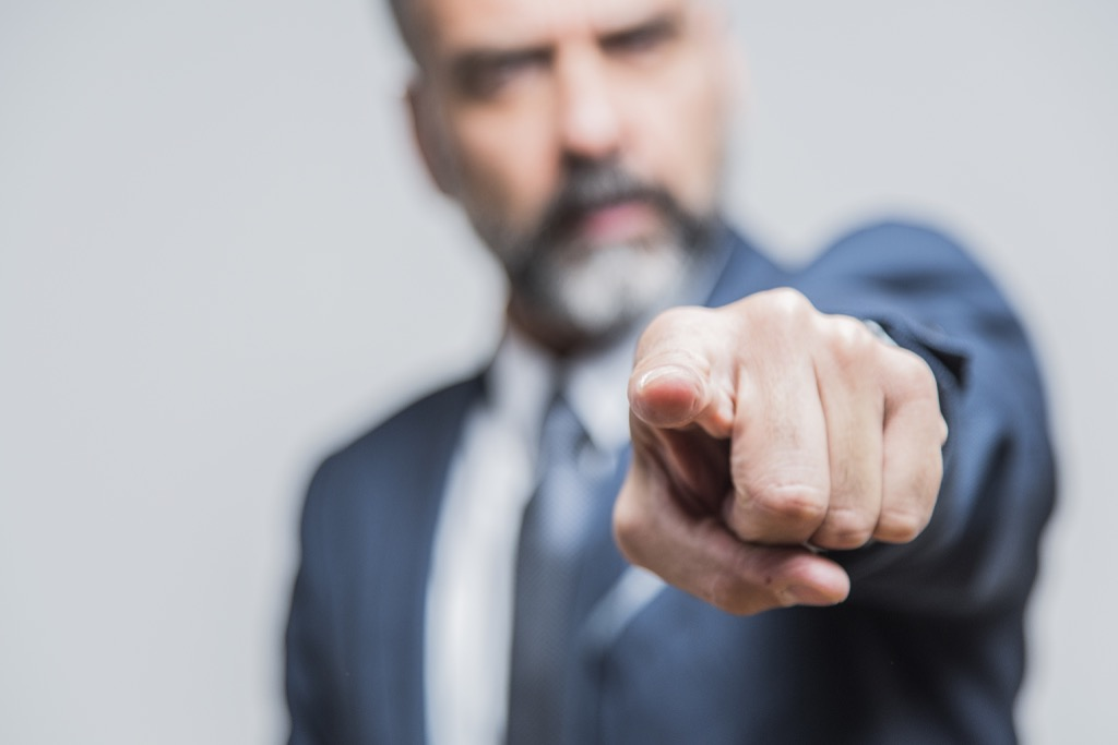 Man pointing the finger at others, etiquette mistakes