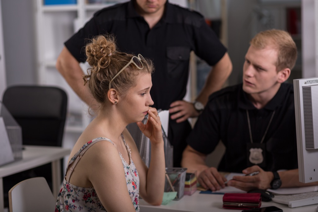 Young woman filing a police report.