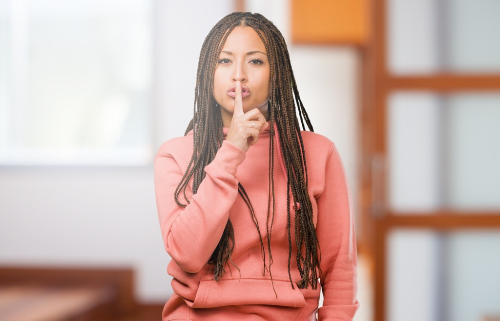 Woman telling people to be quiet, shush