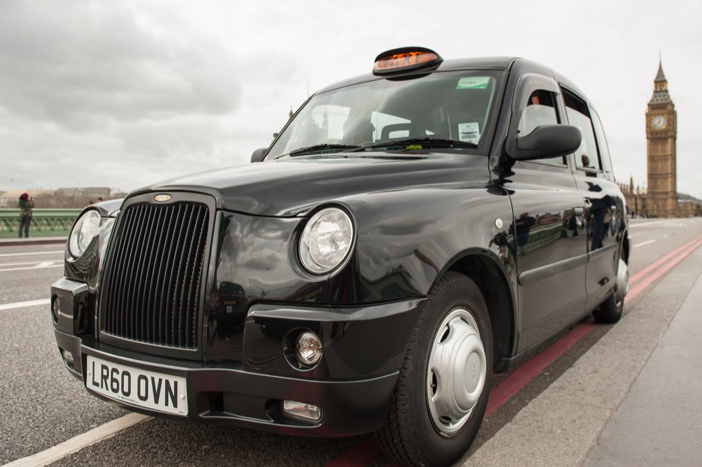 London cab driving away from Big Ben