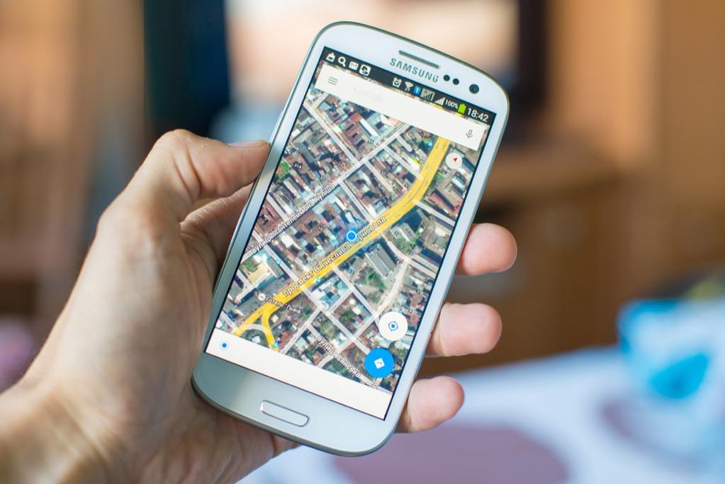 google maps on phone screen, modern tech