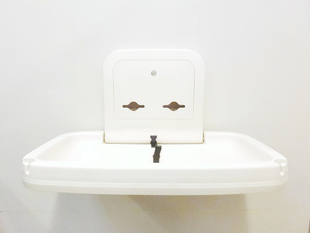 Diaper changing station in public bathroom