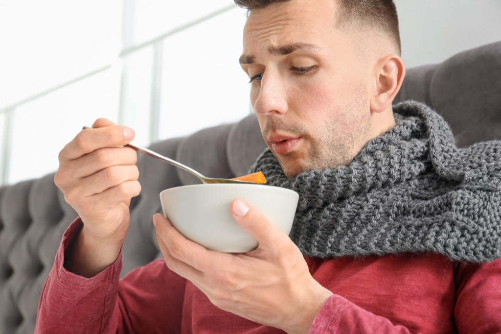 Man is sick in bed with some soup.  - old wives' tales