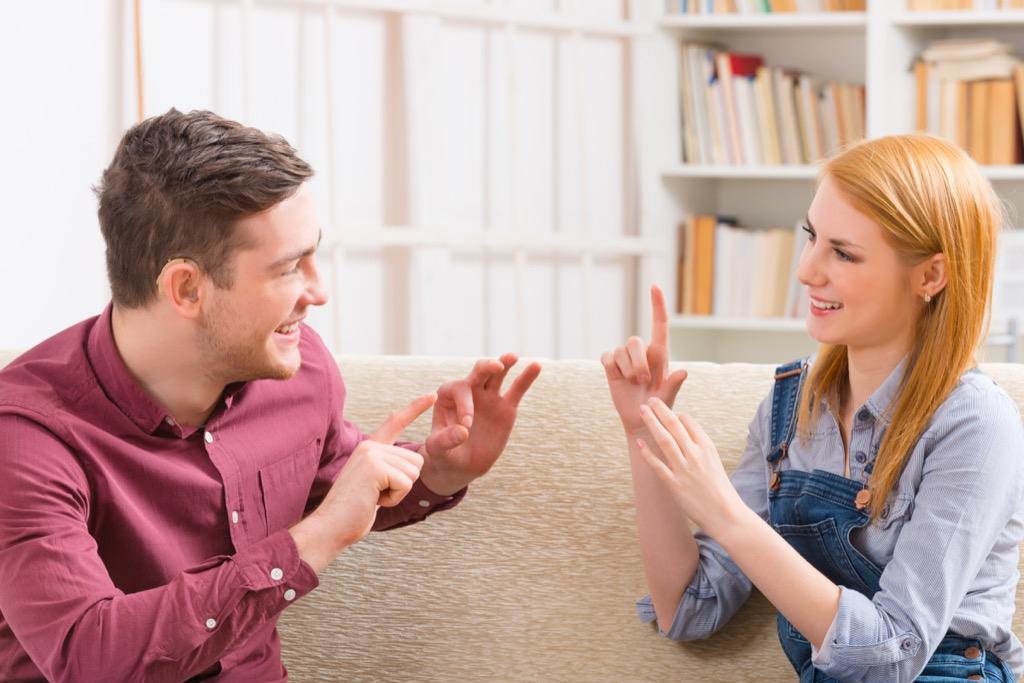 Two people using sign language.