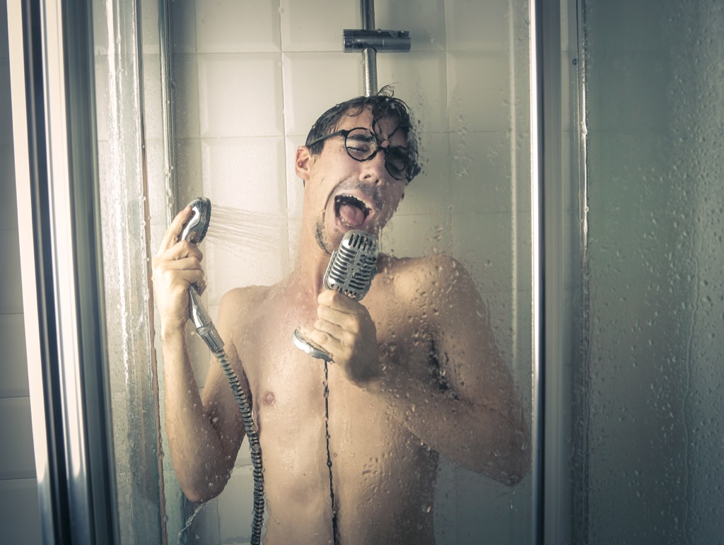 man is singing in the shower.