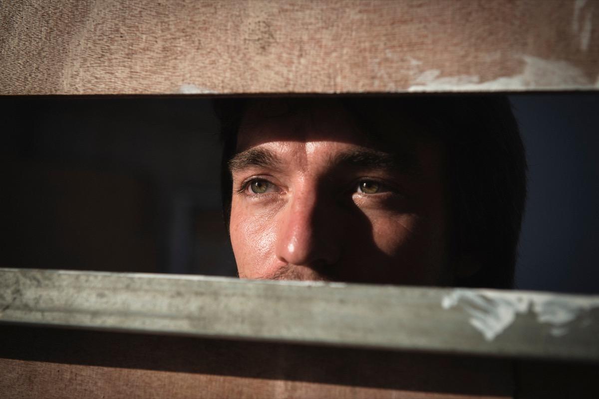 man staring through fence, astonishing facts