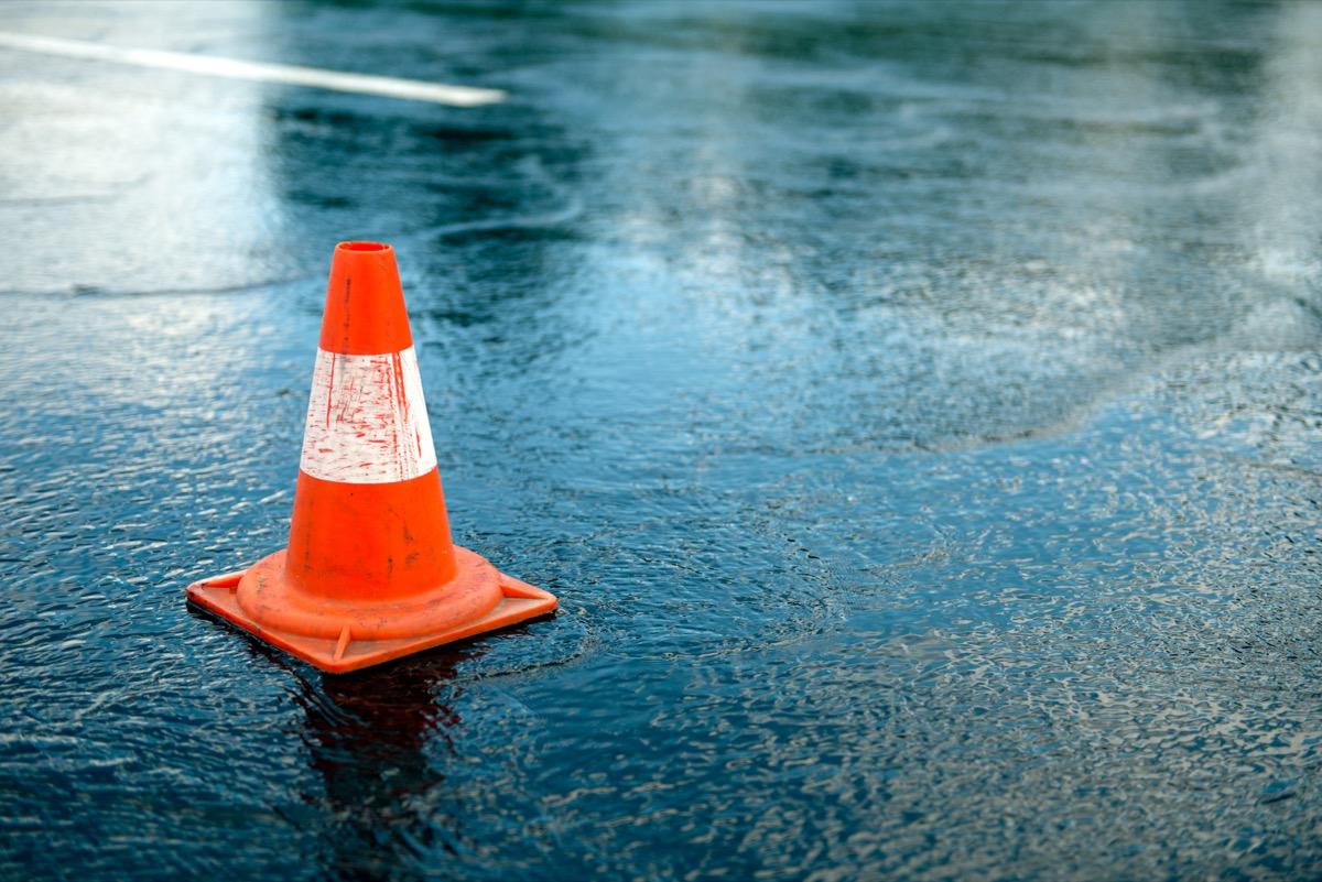 Traffic cone on rainy street