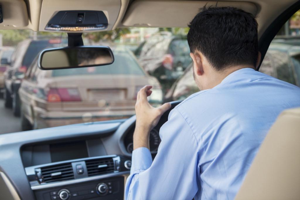 man yelling in a car