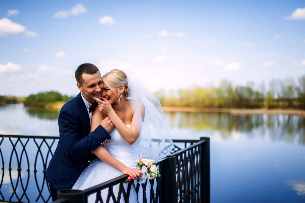 bride and groom by lake this is the age most people get married in every US state