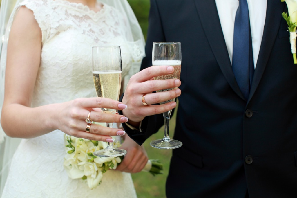 wedding couple holding champagne this is the age most people get married in every US state