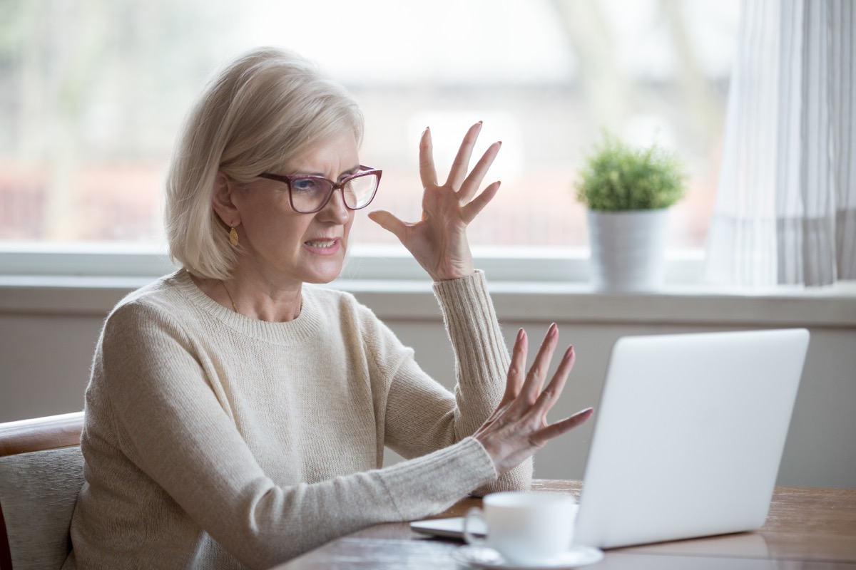 woman angry using computer