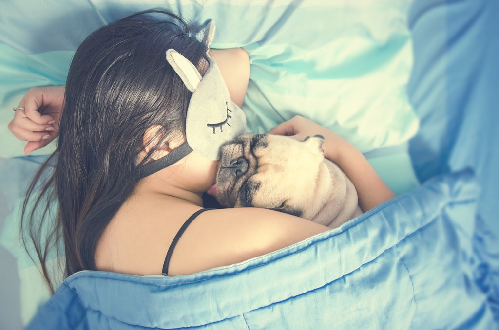 woman napping with pug
