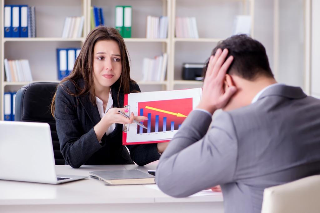woman scorning man in office
