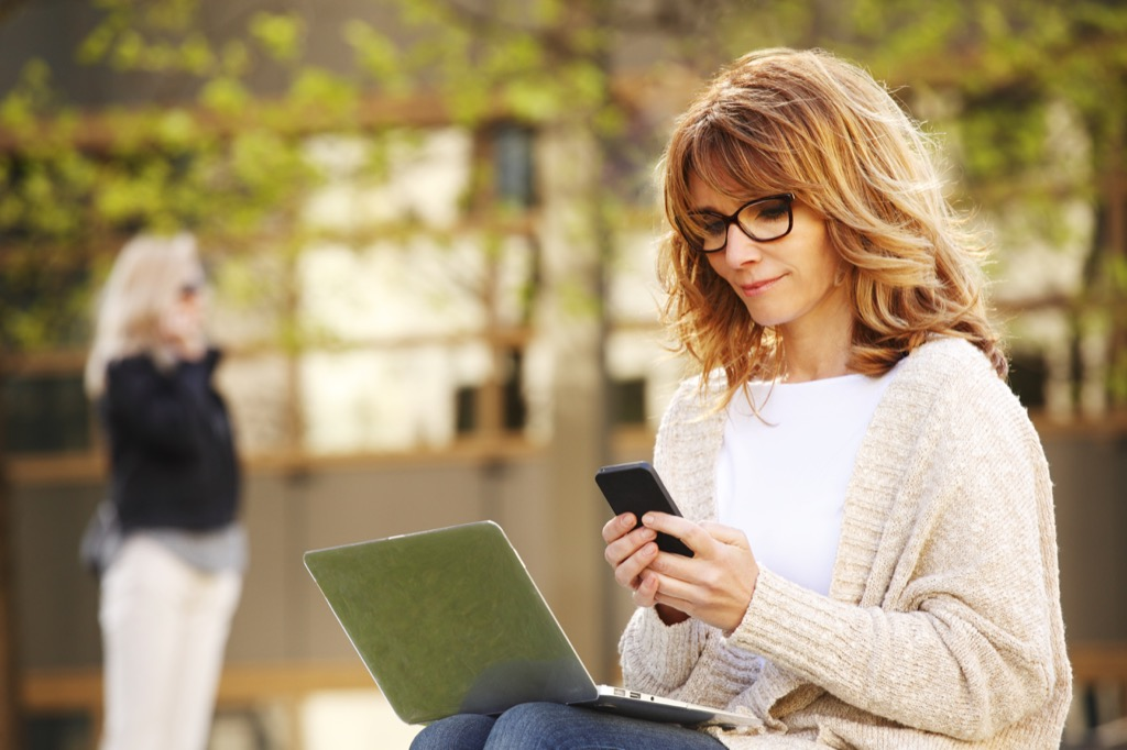 woman working on smartphone and laptop computer, annoying things people do