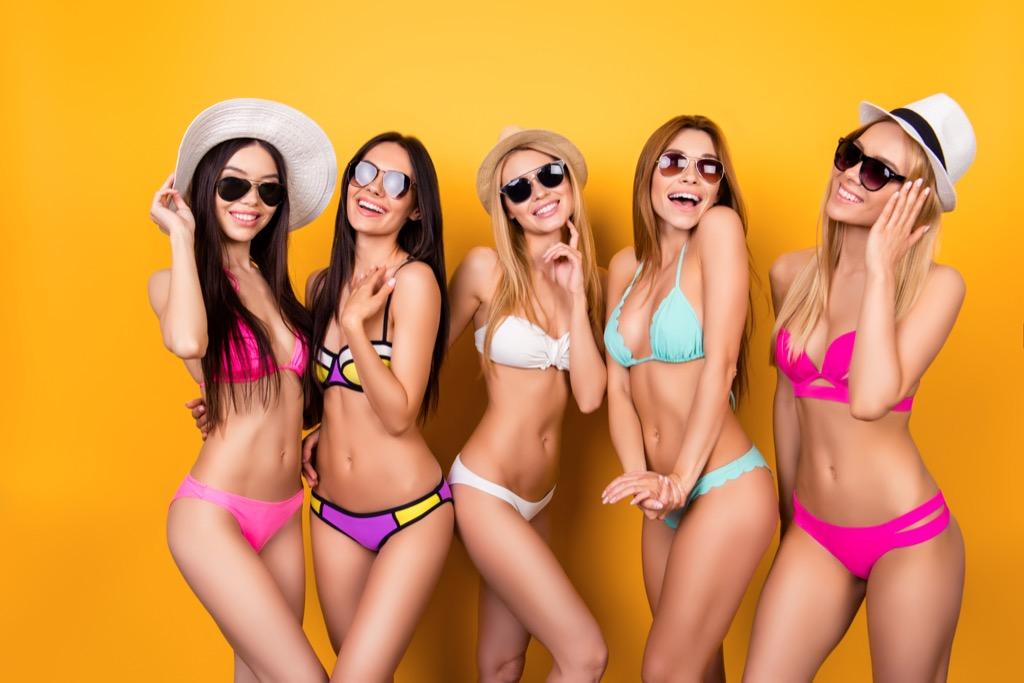women wearing bikinis against a yellow background