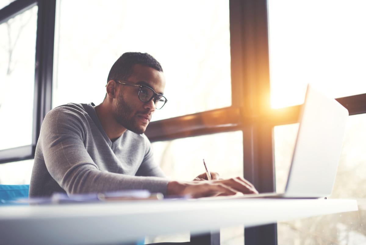 African American copywriter focusing at work