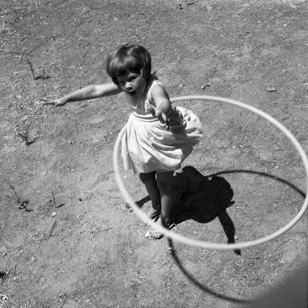 little girl using a hula hoop in the 1950s