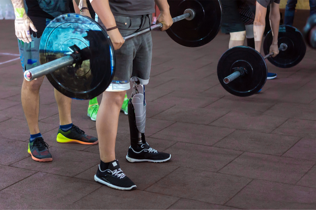 Man with prosthetic leg lifting a barbell