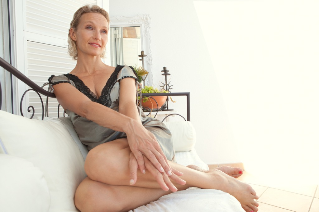 mature woman in nightgown in bed
