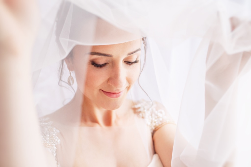 bride wearing veil 20 Old-Fashioned Wedding Traditions That Nobody Does Anymore