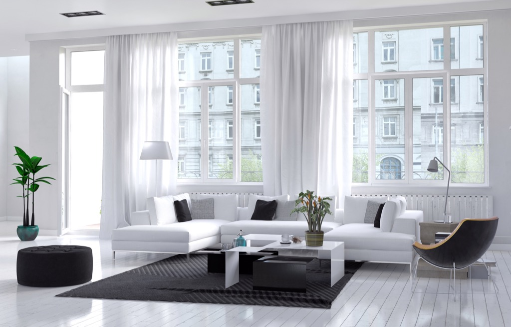 bright white living room with a large rug
