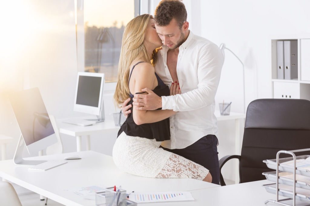 Woman is cheating with her boss or a coworker at work