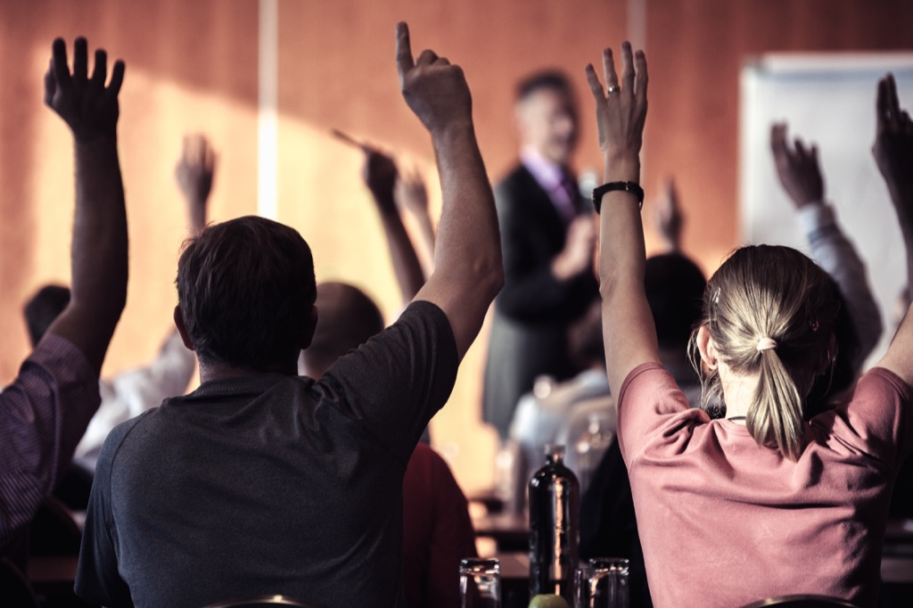 kids raising hands in school things grandparents should never do