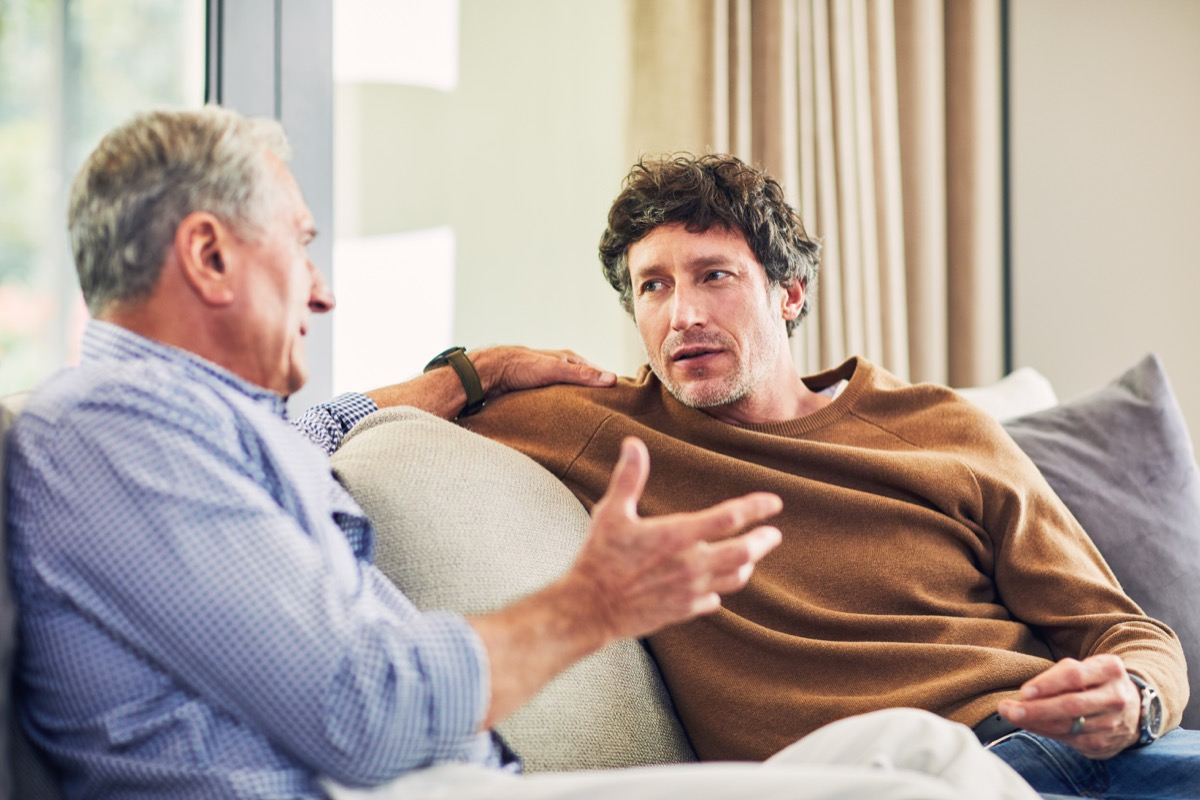 old man having a serious conversation with his elderly father