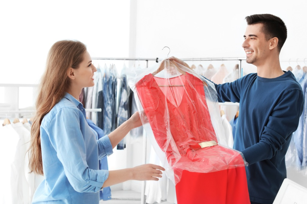 woman picking up dry cleaning