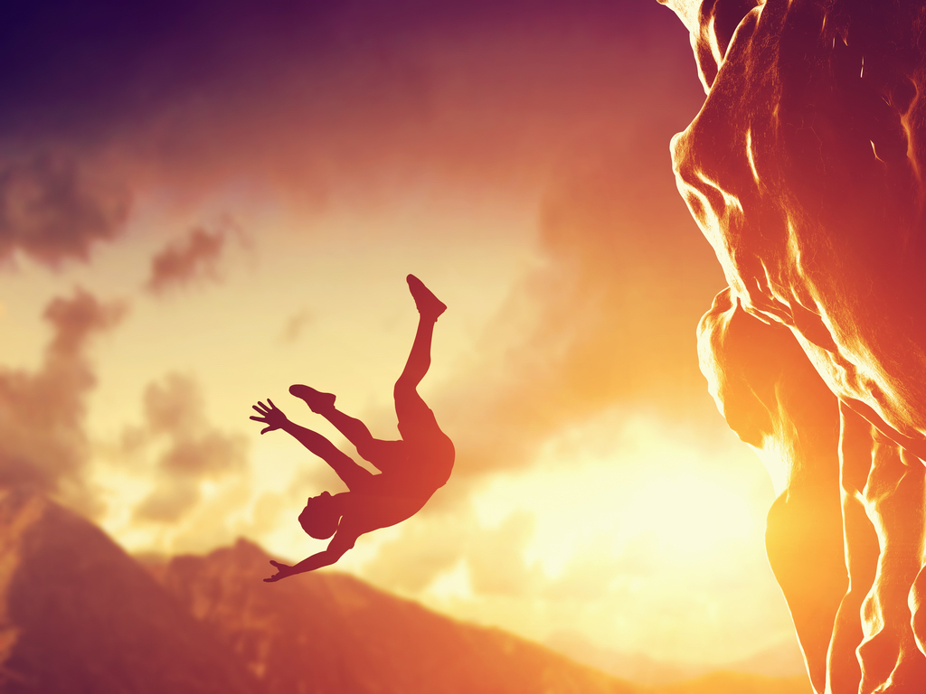 Man falling off cliff in a dream