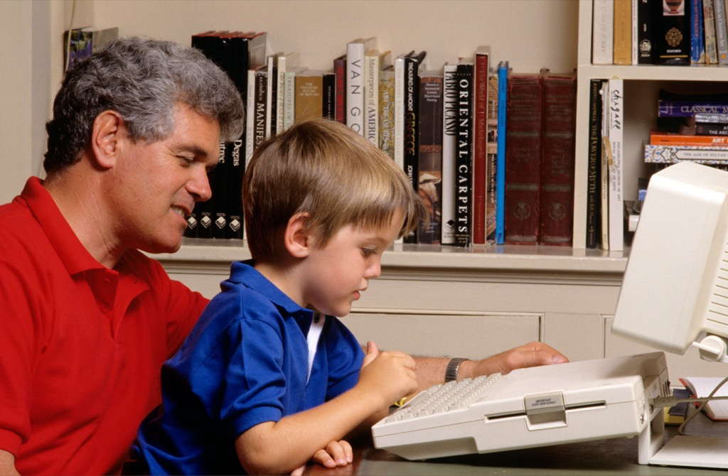 father and son on dial up computer in the 1990s