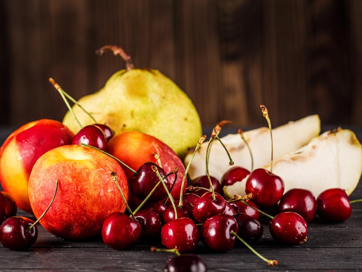 fruit basket with apples, pears, cherries