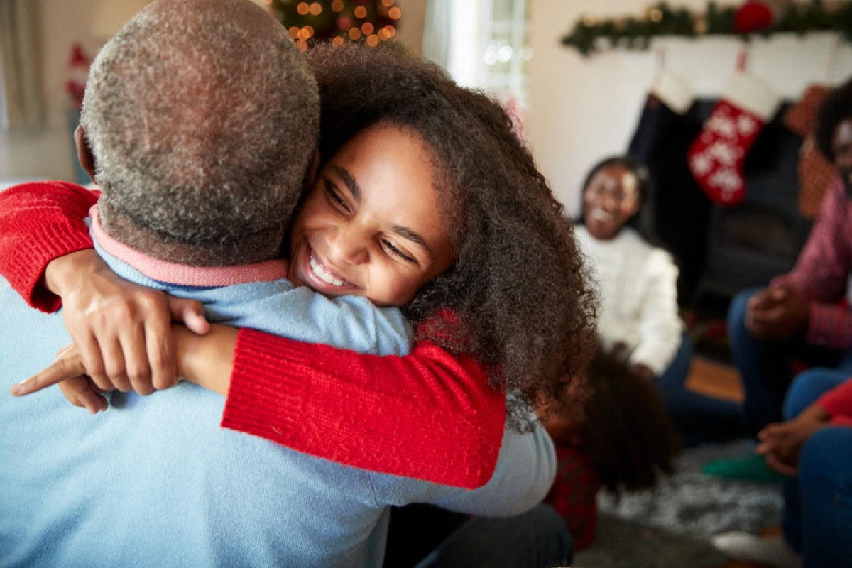 girl hugging grandfather things grandparents should never do