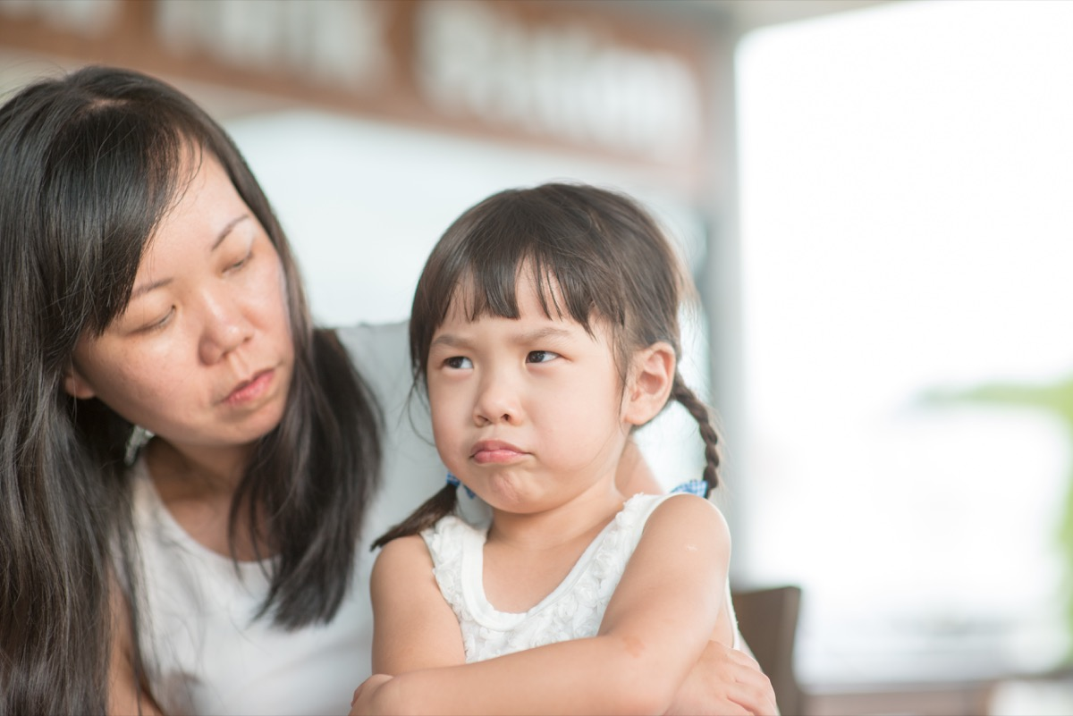 little girl upset with her mother, pouting
