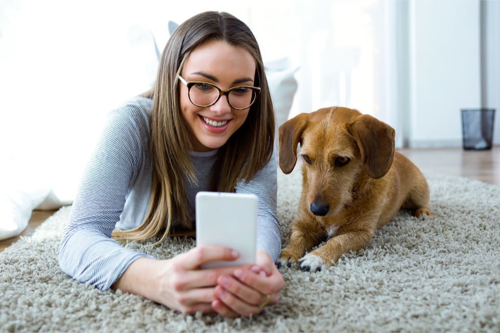 woman taking selfie with dog things you never knew dogs could do