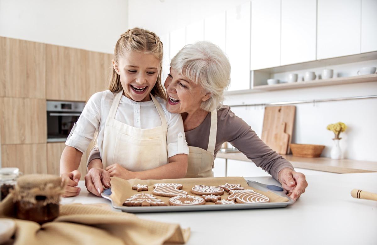 Grandma baking cookies with granddaughter