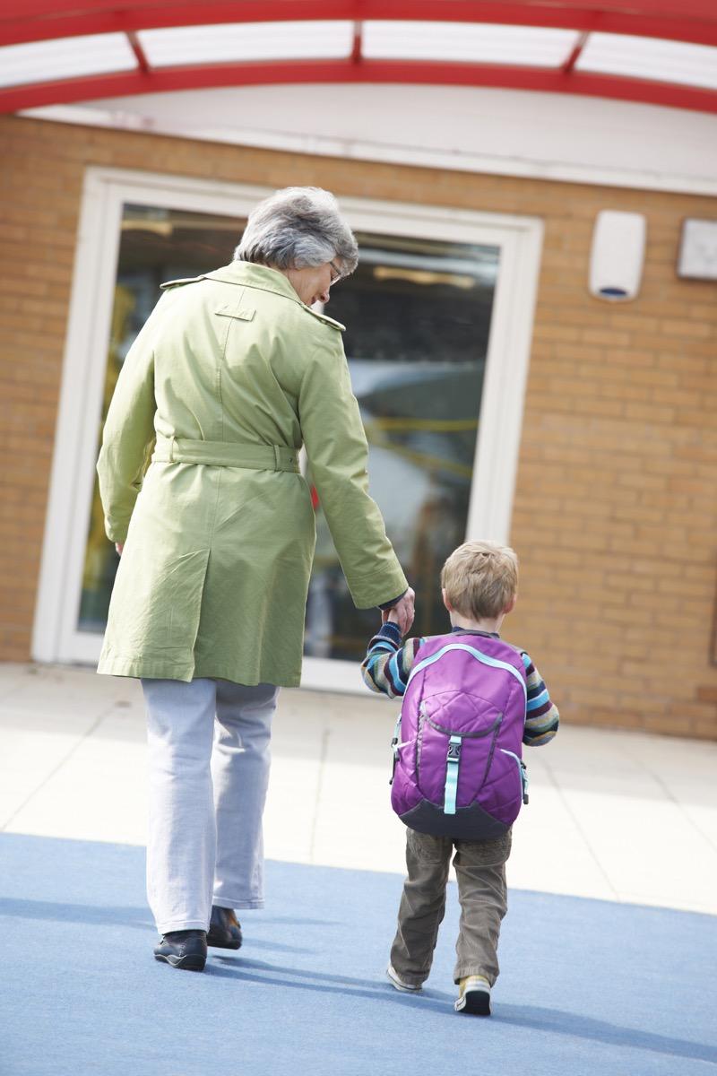 Grandma walking grandson to school