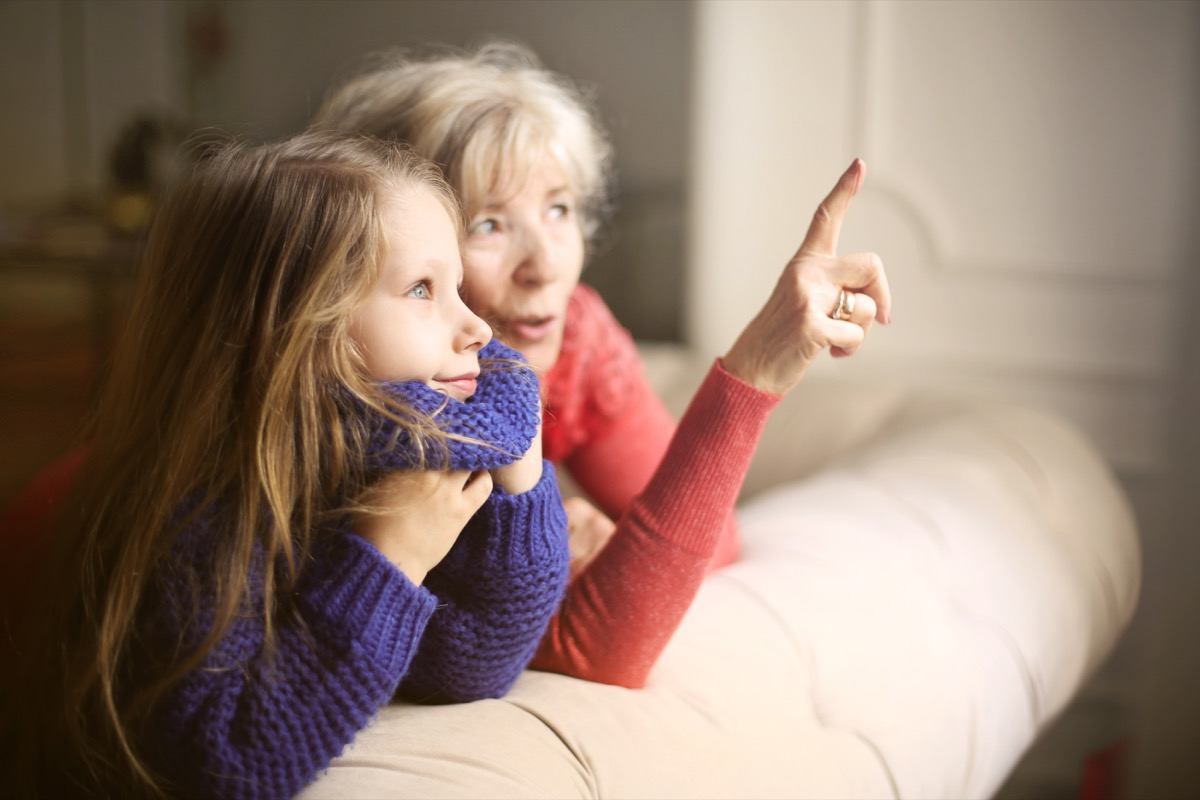 Grandmother talking with granddaughter