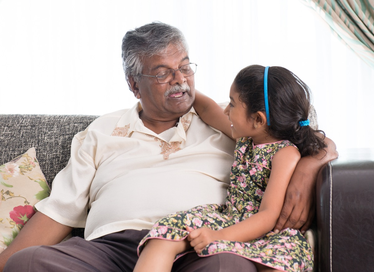 Grandfather talking to granddaughter