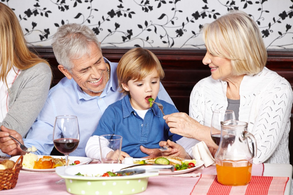 Grandparents eating with their grandchild