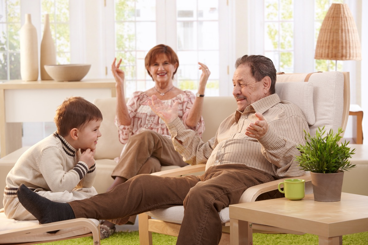 Grandparents telling grandchild a family story