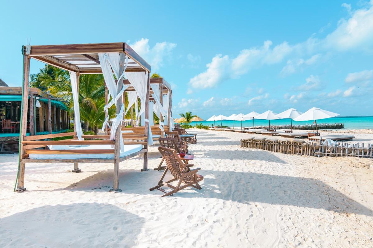 cabanas on a white sand beach