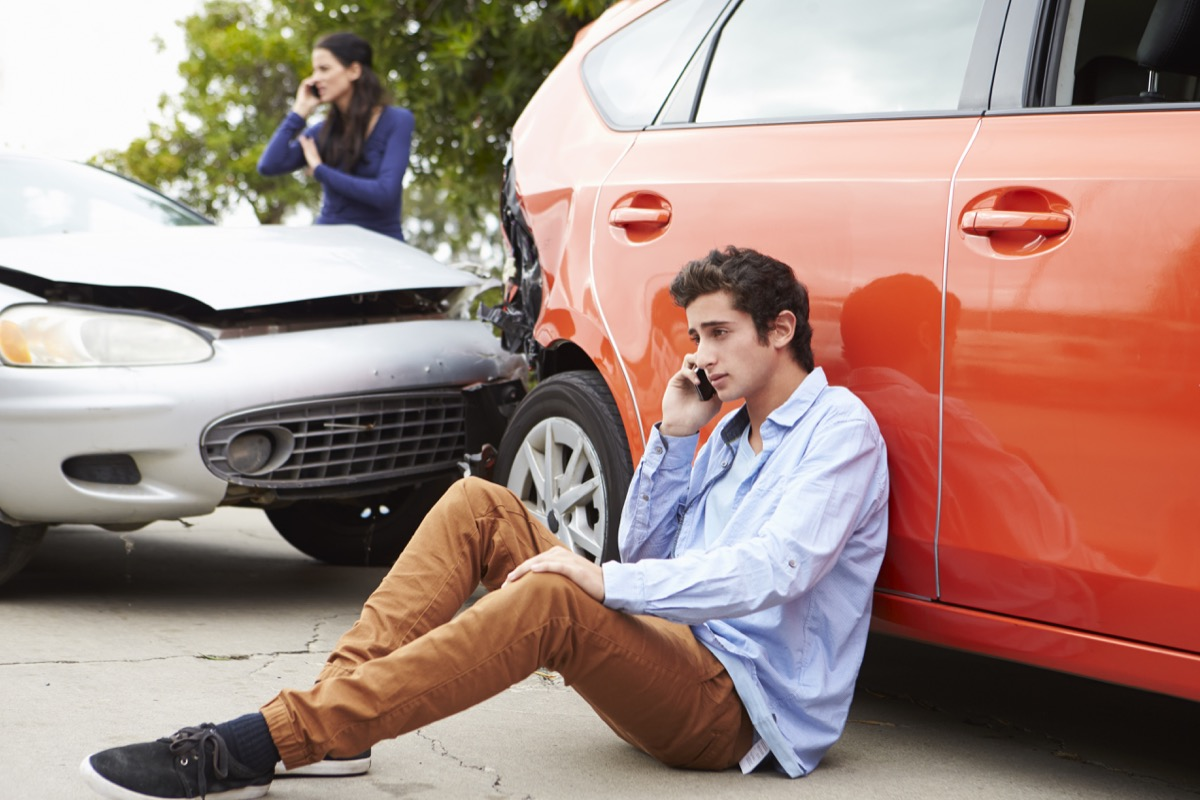 teenage kid calling his mom after getting in a car accident