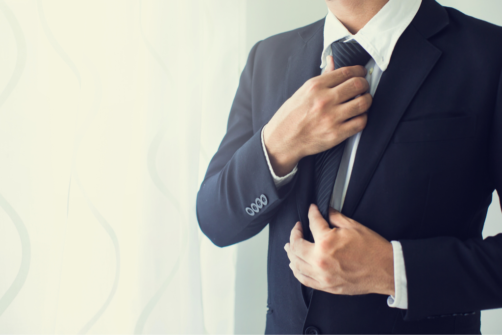 Man Fidgeting with Suit Body Language That Kills First Impressions