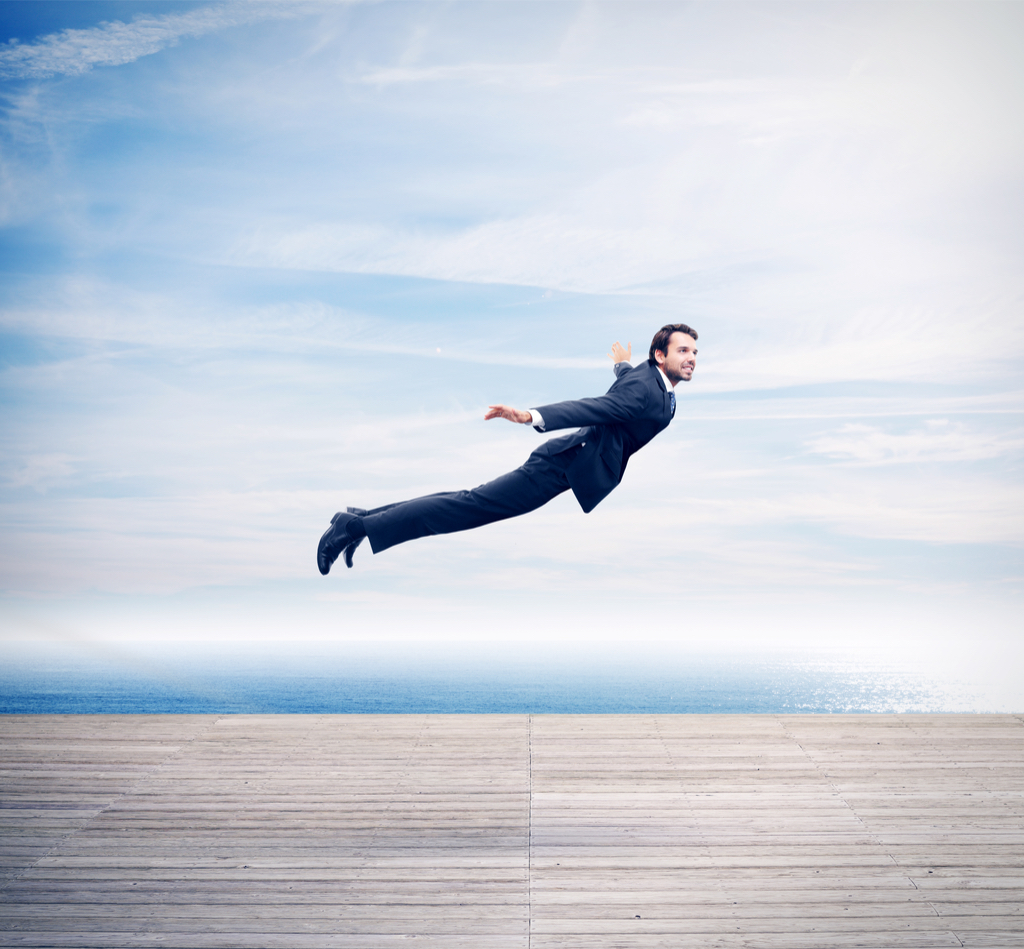 Man in suit flying