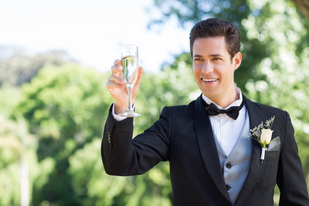 man giving toast 20 Old-Fashioned Wedding Traditions That Nobody Does Anymore